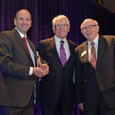 David Cowen and MoAF Chairman Dick Sylla present Charles Schwab with the 2016 Financial Innovation Award