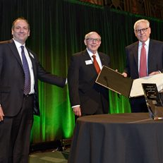 David Cowen and MoAF Chairman Dick Sylla present David Rubenstein with the 2015 Whitehead Award