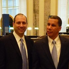 David Cowen with Governor David Paterson at a press conference on the New York economy in 2010