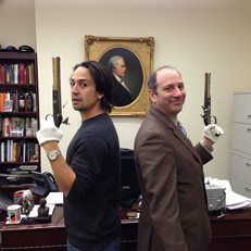 Lin-Manuel Miranda and David Cowen with replica pistols from the Hamilton/Burr duel